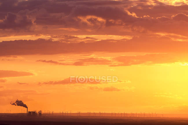 Industrial area and wind park at sunset, Leipzig, Germany — Stock Photo