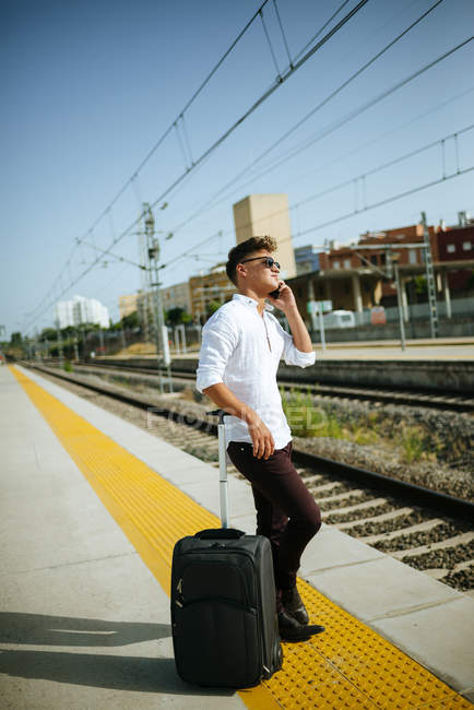 Young man on cell phone — Stock Photo