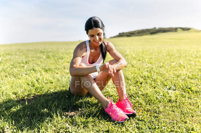 Asturias, Spain, fitness woman getting ready for training outdoors — Stock Photo