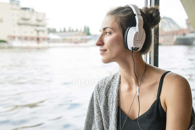 Relaxed woman listening music with headphones — Stock Photo