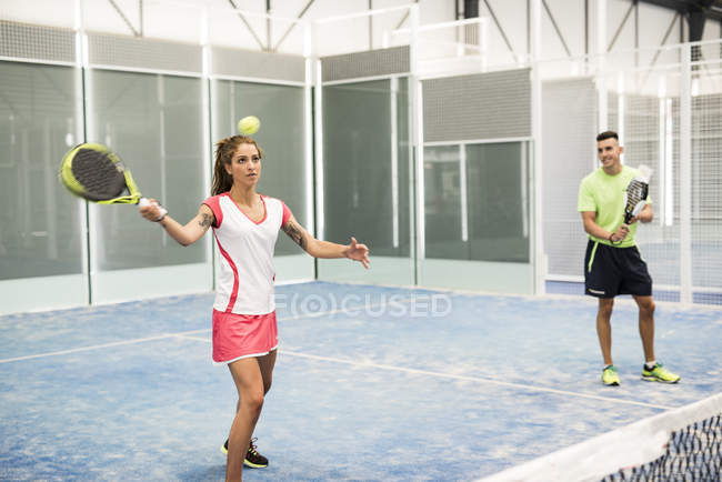 Two paddle tennis players on court playing a match — Stock Photo