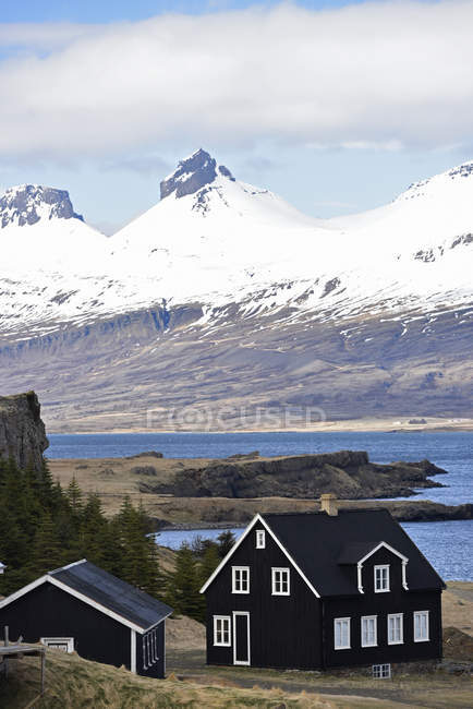 Black houses and landscape — Stock Photo