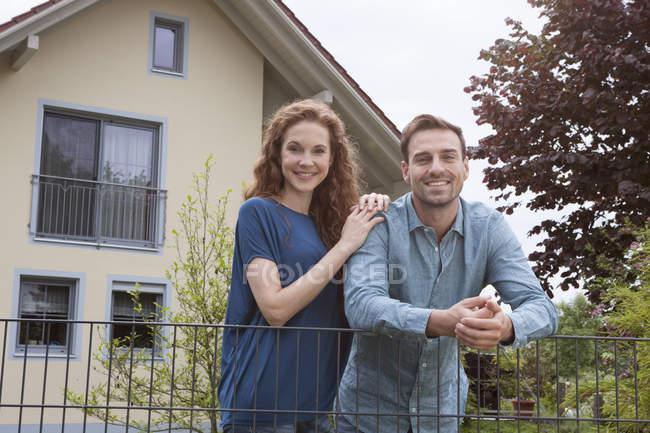 Couple at garden fence — Stock Photo