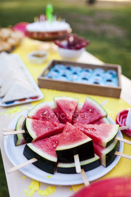 Close up of Birthday table with watermelon lollipops — Stock Photo