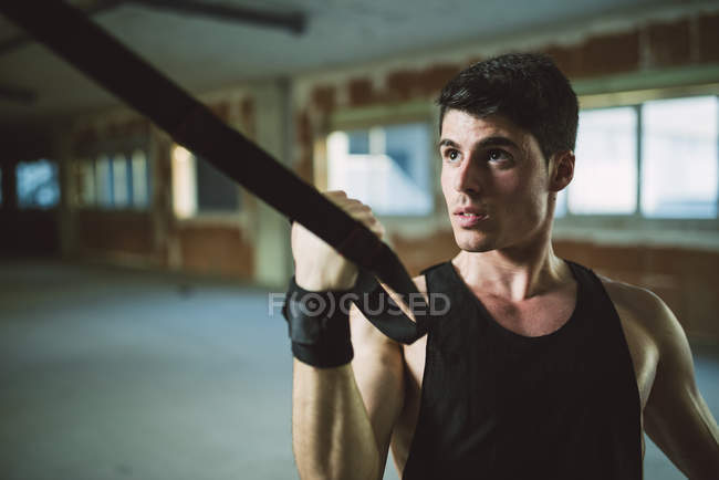 Man exercising suspension training trx — Stock Photo