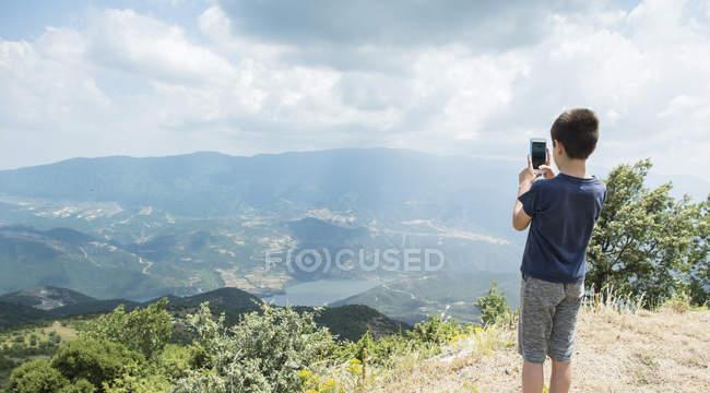 Boy taking photos in mountains of Central Macedonia, Greece — Stock Photo