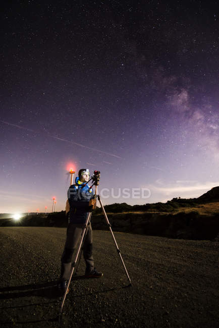 Photographer practicing astrophotography at night in nature — Stock Photo