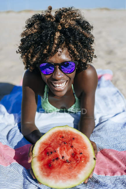 Happy young woman with watermelon — Stock Photo