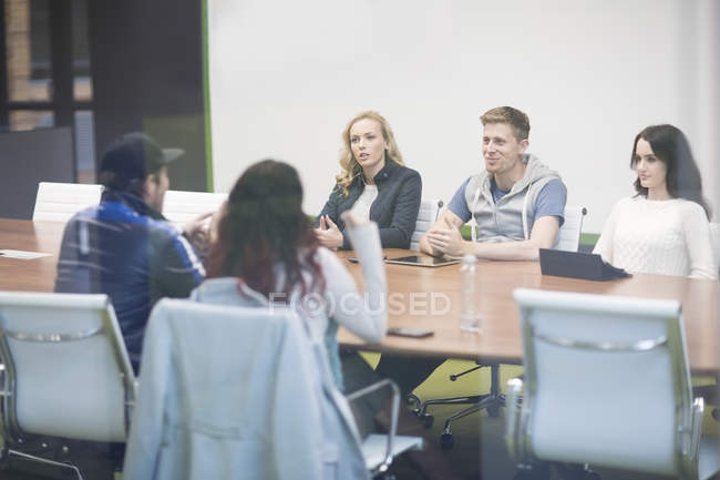 Young people discussing in business meeting — Stock Photo