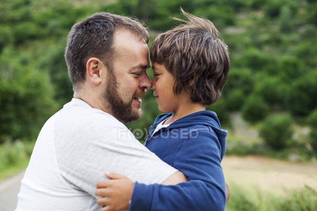 Happy father and little son face to face — Stock Photo