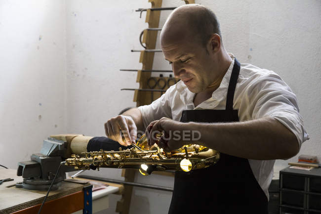 Instrument maker working in his workshop — Stock Photo