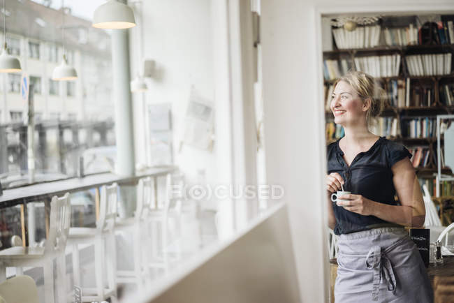 Smiling woman in a cafe — Stock Photo