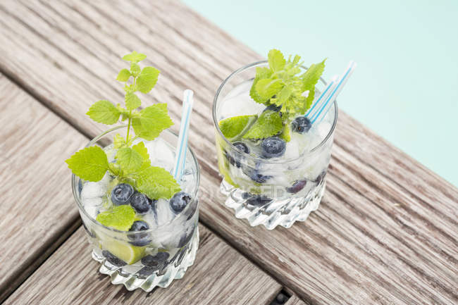 Fresh mineral water with blueberries — Stock Photo