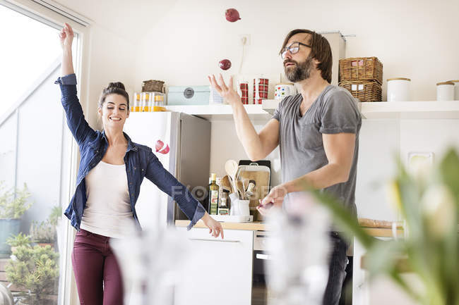 Playful couple in kitchen — Stock Photo