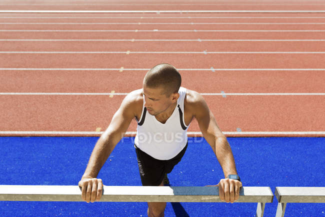 Young sportsman stretching — Stock Photo