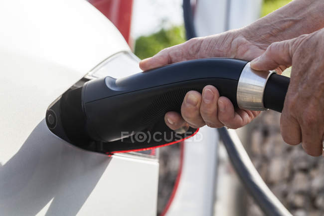 Charging of an electric car, close-up — Stock Photo