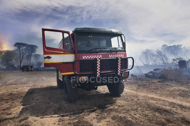 South Africa, Stellenbosch, fire truck parked on devastated land after a bush fire — Stock Photo