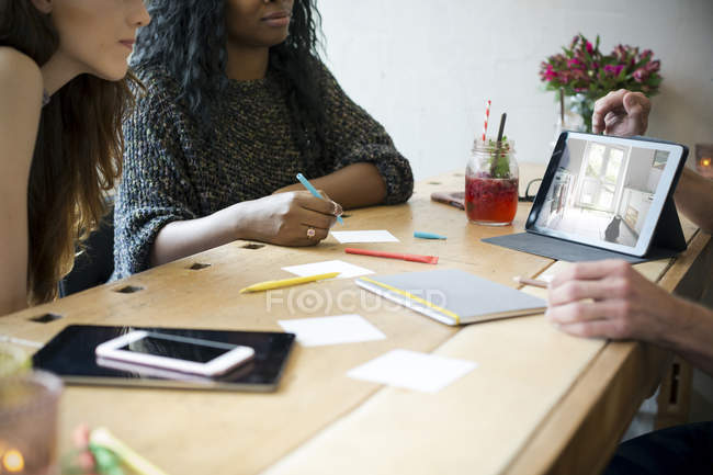 Young business poelpe having meeting in a cafe — Stock Photo