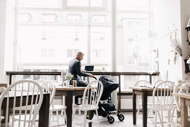 Businessman sitting in cafe — Stock Photo