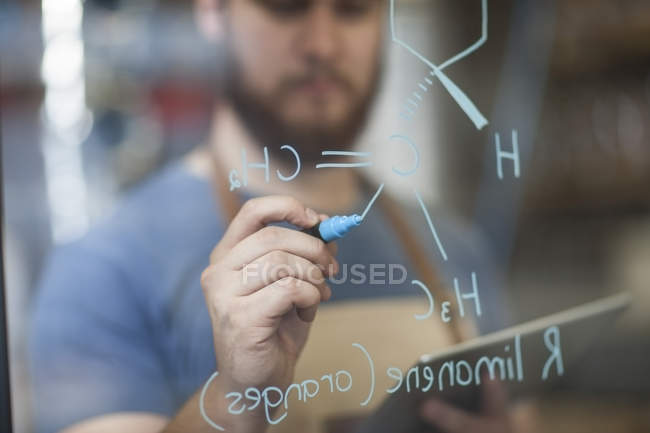 Man writing formula — Stock Photo