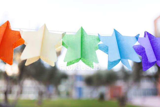 Star-shaped birthday garland made of paper — Stock Photo