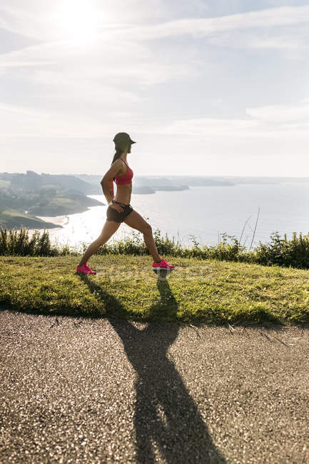 Asturias, Spain, fitness woman doing stretching outdoors — Stock Photo