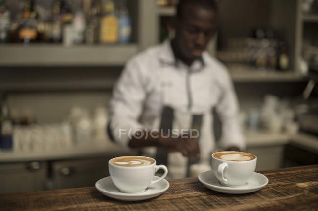 Two cappuccinos on counter in modern bar — Stock Photo