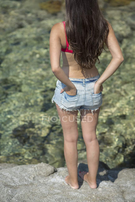 Woman with short jeans and bikini top — Stock Photo