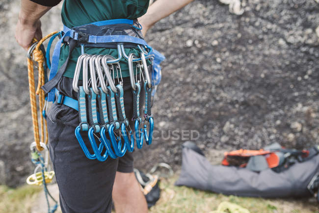 Close-up of climber standing near rock with climbing equipment — Stock Photo