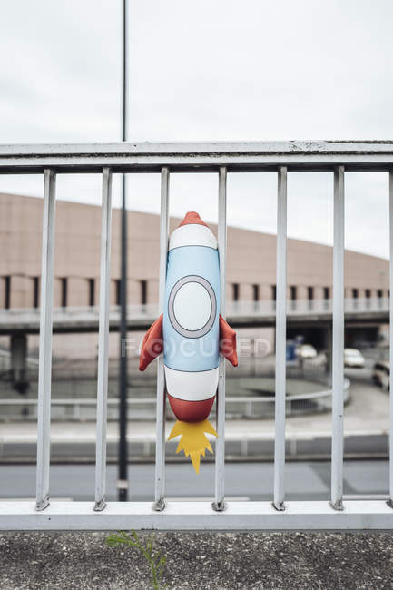 Toy rocket stuck in railing — Stock Photo