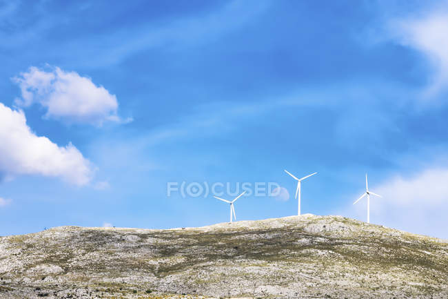 Wind turbines with moon — Stock Photo