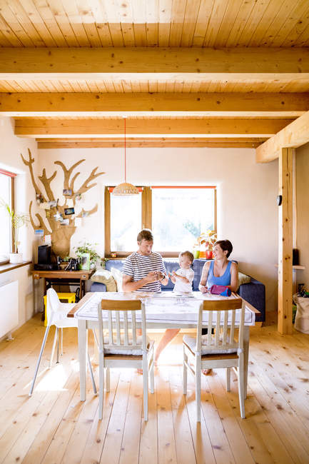 Family tinkering at kitchen table — Stock Photo
