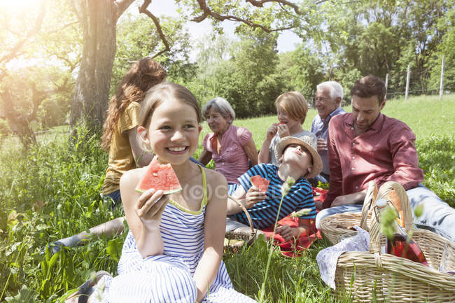 Girl with watermelon at family picnic in meadow — Stock Photo