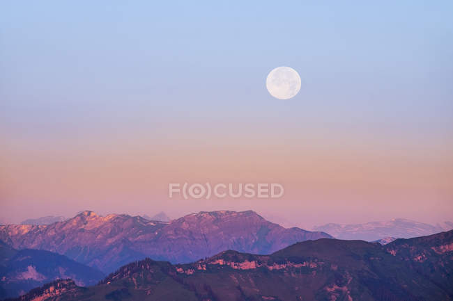 Germany, Bavaria, Allgaeu, Hoher Freschen with fullmoon — Stock Photo