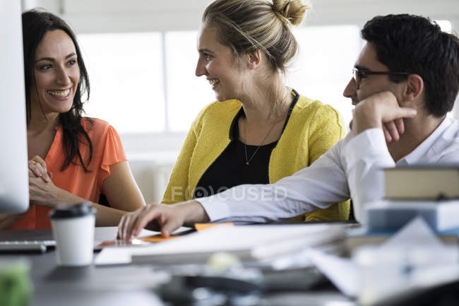 Colleagues working together in modern office — Stock Photo