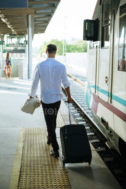 Young man leaving the train — Stock Photo