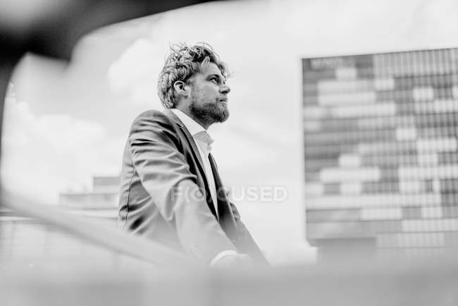 Businessman standing on bridge — Stock Photo