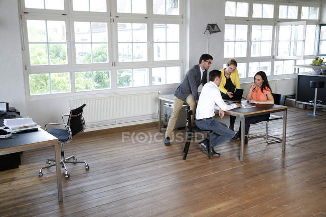 Group of business people discussing in office — Stock Photo