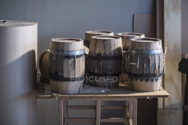Close-up of wine barrels on table in cooperage — Stock Photo