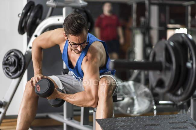 Man lifting dumbbell — Stock Photo