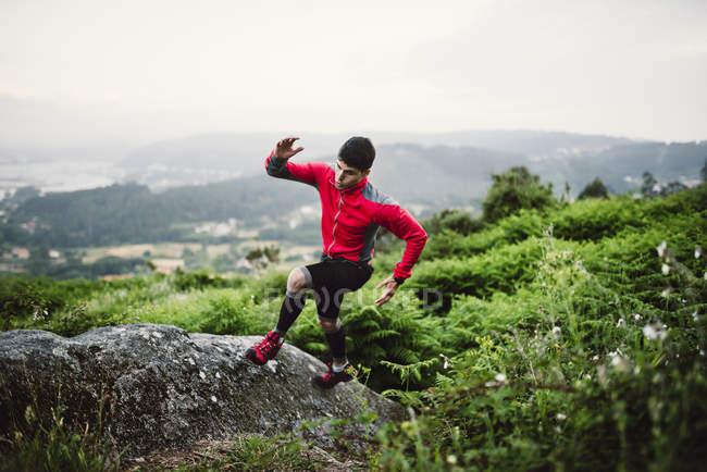 Trail runner man training in nature — Stock Photo