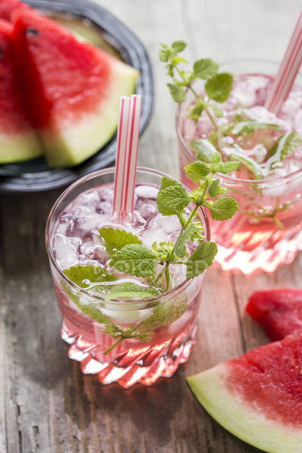 Fresh mineral water with watermelon, sirup and ice in glasses — Stock Photo