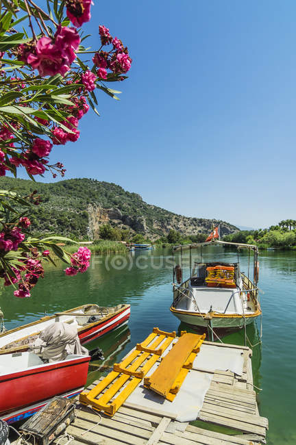 Jetty with moored excursion boats — Stock Photo
