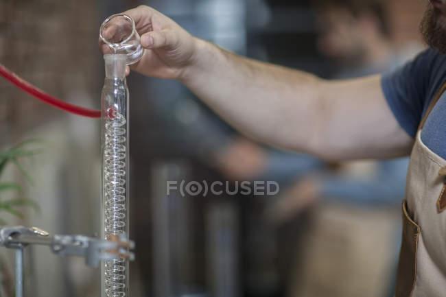 Man working with liquid — Stock Photo