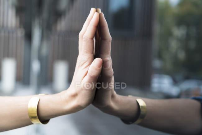 Woman's hand touching glass pane — Stock Photo