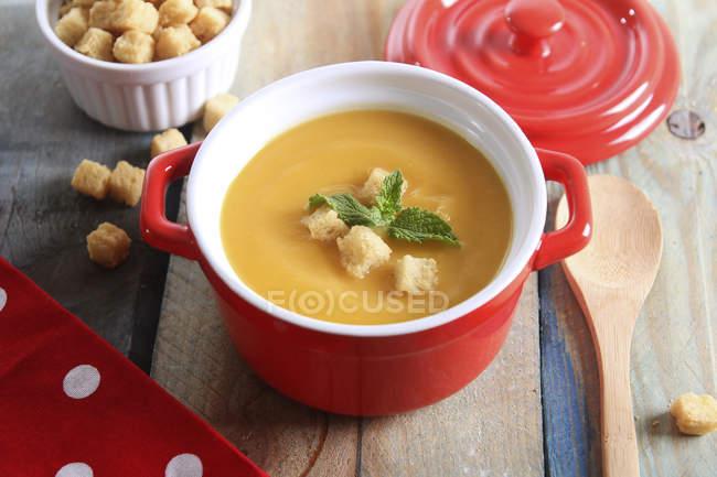 Pot of creamed pumpkin soup — Stock Photo