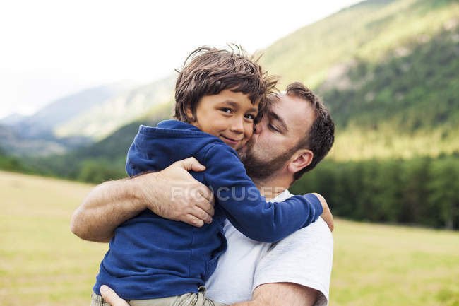 Father kissing his little son — Stock Photo