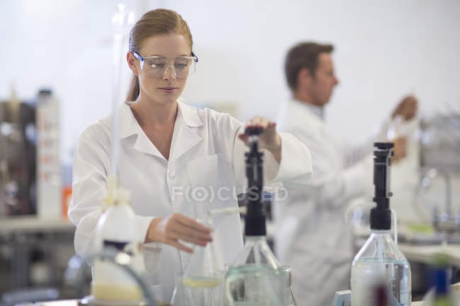 Young caucasian woman working in lab — Stock Photo