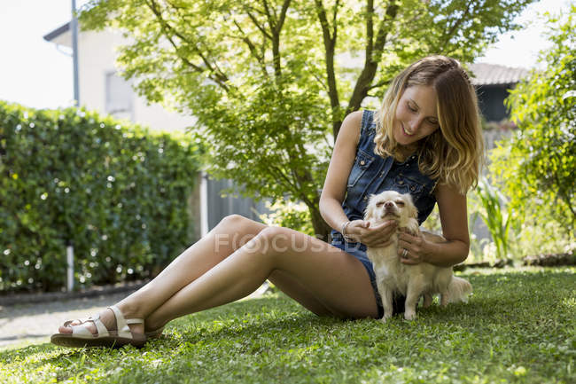 Happy woman with her Chihuahua — Stock Photo