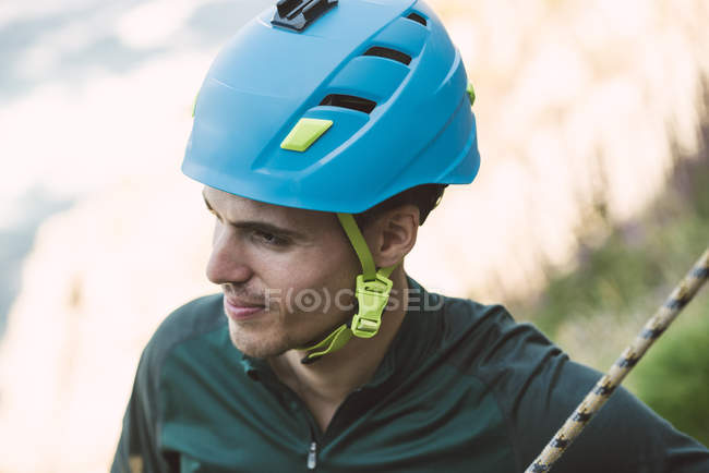 Portrait of climber wearing safety helmet — Stock Photo